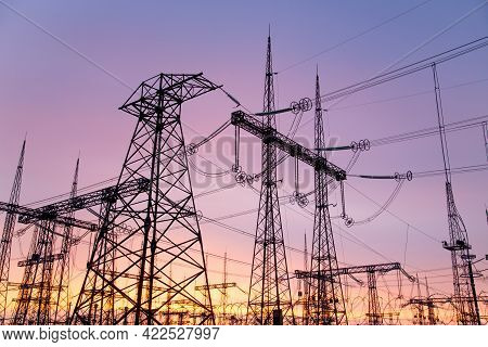 An Extra-high Voltage Substation Against The Backdrop Of A Pink Sunset.