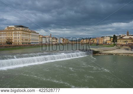 View Of The Arno River From The Bridge Of Amerigo Vespucci In Florence, Italy