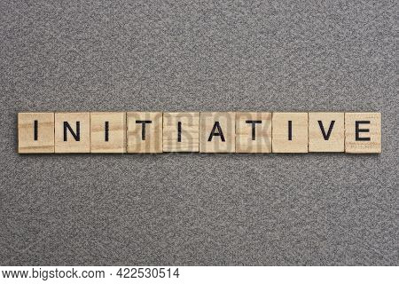 Text The Word Initiative From Wooden Small Letters With Black Font On An Gray Table