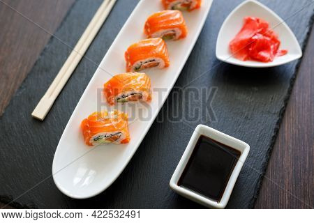 Sushi With Fresh Salmon Served On The Table