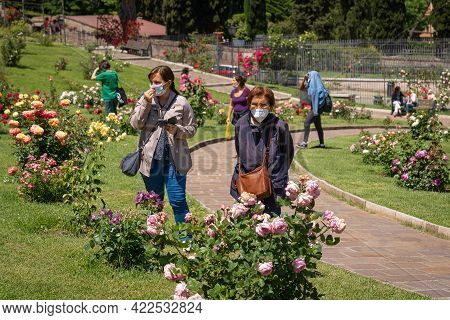 People In Masks And Without In Rose Garden In Rome During Second Year Of Coronavirus Epidemic (covid