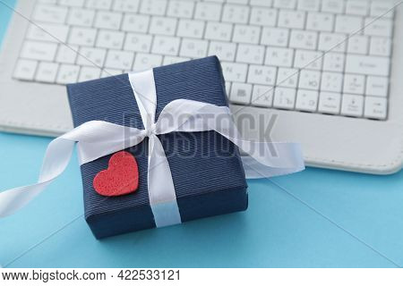 Computer Keyboard And Gift Box Dark Blue Color, Heart On Light Blue Background. Gift For Men. Father