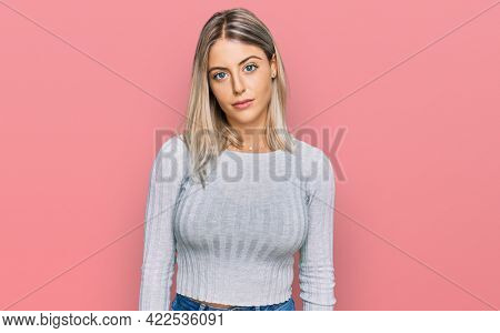 Beautiful blonde woman wearing casual clothes looking sleepy and tired, exhausted for fatigue and hangover, lazy eyes in the morning.