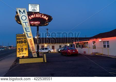 Tucamcari, New Mexico - May 6, 2021: Neon Sign For The Classic Motel Americana, Located Along Route