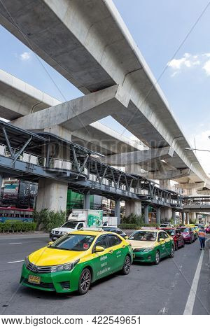 Bangkok Thailand , May 18 , 2021 : The Popular Bts Mass Transit System For People And Many Taxis On