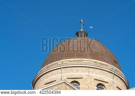 New Orleans, La - April 14: Dome And Cross Of Our Lady Of The Rosary Catholic Church With Moon In Ba