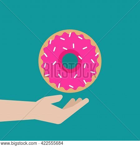 Hand With Pink Strawberry Donut Isolated On Blue Background. Sweet Sugar Icing Doughnuts. Tasty Glaz