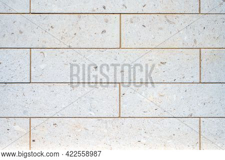 Background From A Wall With Rectangular Granite Stone Slabs