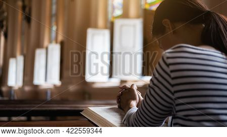 Christian Woman Praying On Holy Bible In The Public Church. Woman Pray For God Blessing To Wishing H