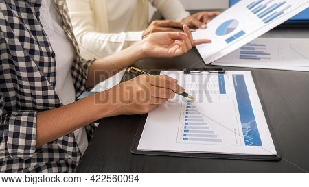 Business Team Brainstorming And Discussing With Financial Data And Report Graph. Teamwork Meeting Wo