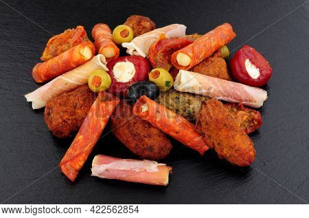 Group Of Savoury Appetizer Snacks Including Stuffed Olives, Lamb And Chicken Koftas And Rollitos On