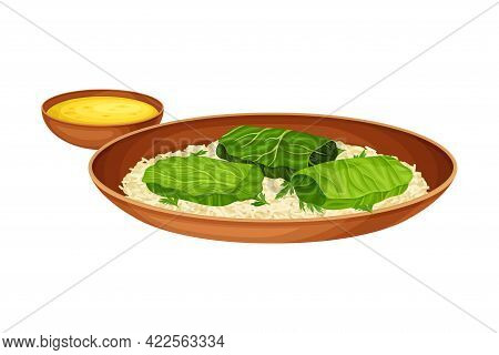 Rice With Meat Stuffing Wrapped In Green Leaves As Indian Dish And Main Course Served On Plate And G
