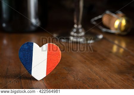 A Heart In The Colors Of The French Flag And A French Champagne Bottle Cork In The Background On The