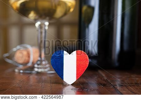 A Heart In The Colors Of The French Flag, A Glass And A French Champagne Bottle Cork In The Backgrou