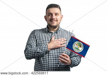 White Guy Holding A Flag Of Belize And Holds His Hand On His Heart Isolated On A White Background Wi