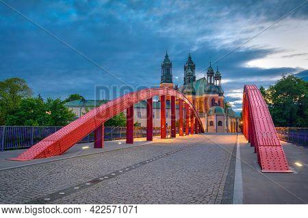 Poznan, Poland. View Of Jordan Bridge (most Jordana) And Poznan Cathedral At Dusk