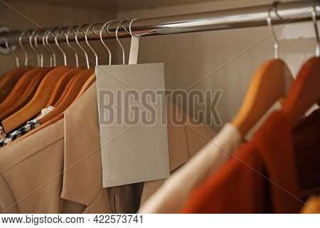 Scented Sachet And Clothes Hanging In Wardrobe