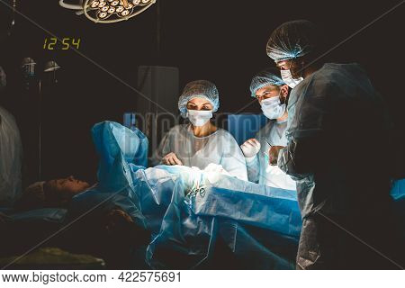 The Senior Surgeon In The Operating Room, Where The Patient Is Waiting For Him, And He Begins The Op