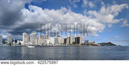 Waikiki - Feb 19, 2018: Panoramic Of Boat Sailing Into Ala Wai Harbor With Skyline Of Waikiki, Diamo
