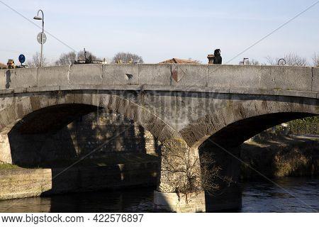 Robecco Sul Naviglio ( Mi ), Italy - April 01, 2021: An Old Bridge Robecco Sul Naviglio Town And Nav