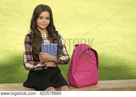 Small Kid In Formal Uniform Hold Book Sitting On Park Bench With School Bag, Knowledge