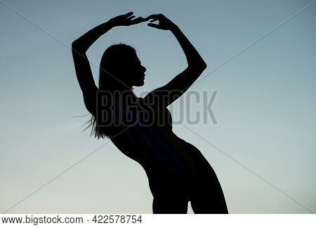 Female Silhouette Of Mysterious Woman In Dusk Silhouetted On Evening Sky, Mystery