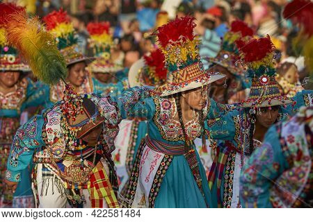 Arica, Chile - January 22, 2016: Tinkus Dancing Group In Colourful Costumes Performing A Traditional