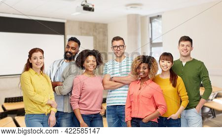 diversity, education and school concept - group of smiling international university students over lecture hall on background