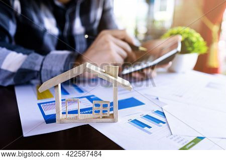 Businessman Or Real Estate Agency Using Calculator To Working About The Price Of Housing, Loan House