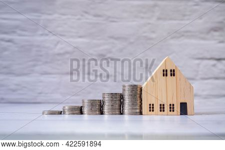 Real Estate Or Home Savings And Coin Piles Flowing, Property Investment And Home Mortgage Financing