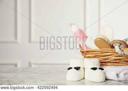 Baby Booties And Accessories On White Marble Table Indoors. Space For Text