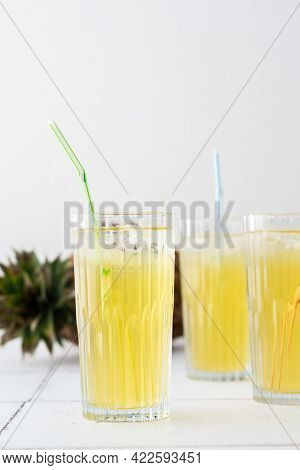 Pineapple Juice In Glasses With A Straw