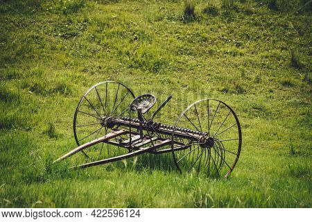 Scenic Green Landscape With Old Altaic Horse Plow With Saddle In Field Among Lush Grasses. Minimalis
