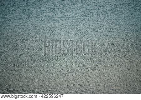 Texture Of Dark Blue Calm Water Of Lake. Meditative Ripples On Water Surface. Nature Minimal Backgro