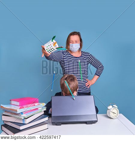 Funny Junior Boy In School Uniform At His Desk With Laptop, Problems Of Remote Learning Due To Coron
