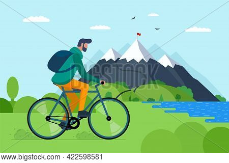 Young Man Riding Bicycle In Mountains. Boy Bicyclist Tourist With Backpack On Bike Travel In Nature.