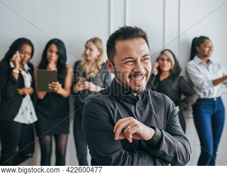 CEO with his employees standing by a white wall