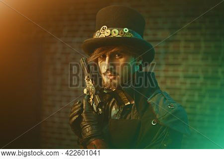 Fantasy world, adventures. Portrait of a courageous steampunk man in a coat and top hat holding a gun.