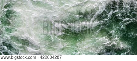 Close-up Abstract Texture Above View Of River Torrent And Clear Fresh Cold Water Flowing Through Mou