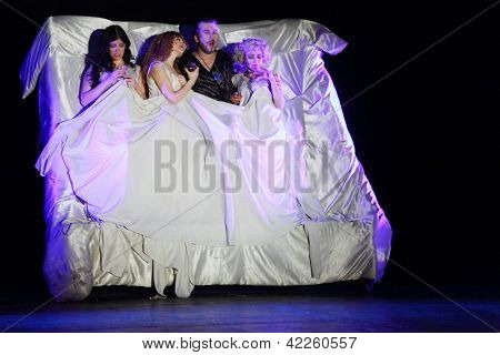MOSCOW - JANUARY 27: Valery Yaremenko, Polina Rostova, Anastasia Makeeva, Olga Vorozhtsova play at Musical Witches of Eastwick in Palace on Yauza on January 27, 2012 in Moscow, Russia.