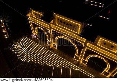 Changhua, Taiwan - Jan 20th, 2020: stone archway with neo light of Bagua Mountain, Changhua city, Taiwan, Asia