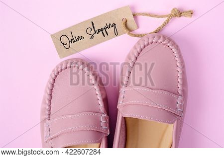 Beautiful Pink Women Shoes With Onlin Shopping Tag On Pink Background. Business Concepts.