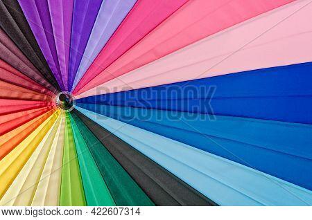 Close Up Rainbow Coloured Umbrella Textured As Background.