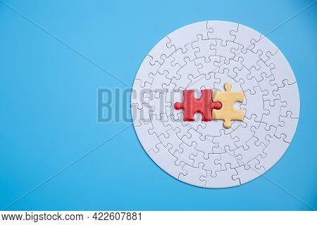 White Jigsaw Puzzle Pieces On A Blue Background. Problem Solving Concepts. Texture Photo With Copy S