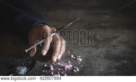 A Crazed Drug Addict Reaches For Another Dose Of The Drug In The Syringe. Guy Addicted, The Concept
