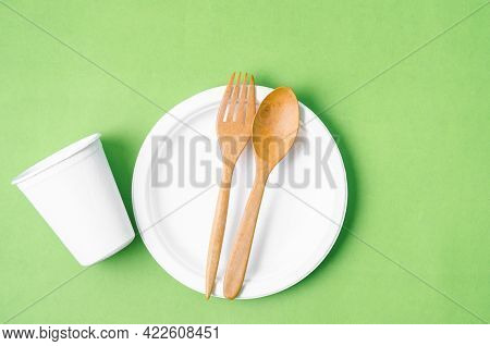 Eco Friendly Biodegradable Paper Disposable For Packaging Food And Paper Glass On Green Background.