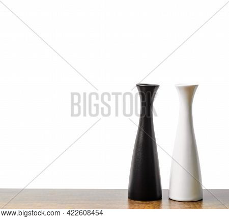 Decorative Empty Black And White Vases On Wooden Table.