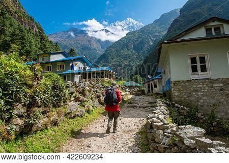 Tourist Walking In Local Sherpa Village In Sagarmatha National Park Of Nepal With View Of Mt.thamser