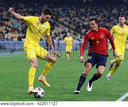 Kyiv, Ukraine - October 13, 2020: Roman Yaremchuk Of Ukraine (l) Fights For A Ball With Pau Torres O