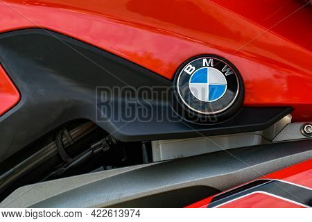 Motorcycle Fuel Tank With Bmw Icon, Close Up. Bmw Logo On High-gloss Red Motorcycle Body. Stylish Ph